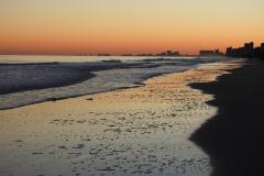 Sunset Beach at Dusk City Skyline