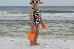 Little Girl Gazes on the Beach - Vertical