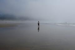 Man Alone on Foggy Beach