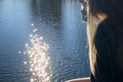 Girl Meditates at Lake