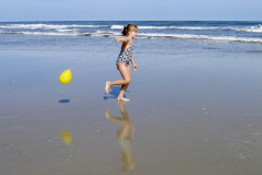 GIrl and Her Balloon on The Beach