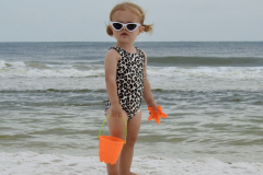 Little Girl Gazes on Beach
