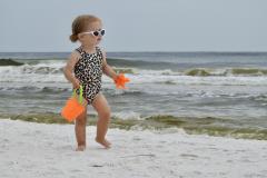 Little Girl Plays on Beach