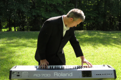 Musician Plays Keyboards Outside