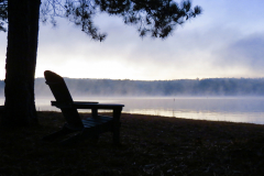 Chair on the Foggy Lake at Sunrise